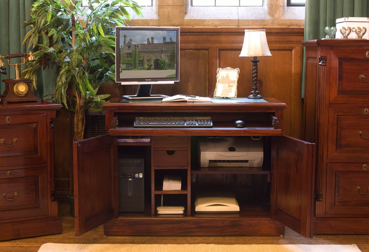 Mahogany furniture at the galleria for Hideaway home office