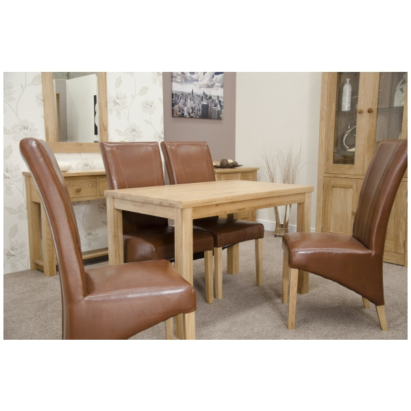 urbana solid oak furniture dining table and four tan leather chairs